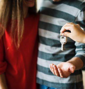 realtor giving keys