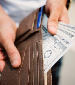 wallet with hundred dollar bills