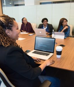 women at conference table