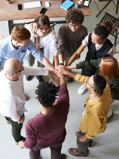 group putting hands in together