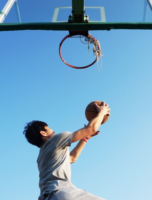 man makes basketball goal